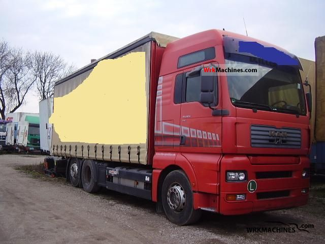 2001 MAN TGA 26.410 Truck over 7.5t Stake body and tarpaulin photo