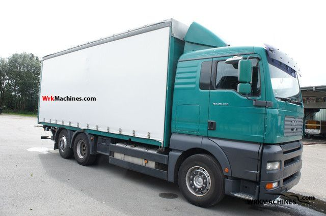 2005 MAN TGA 26.430 Truck over 7.5t Stake body and tarpaulin photo