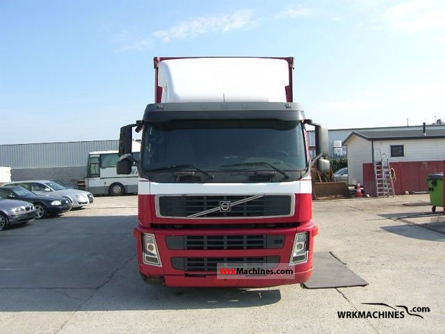 2002 VOLVO FM 9 FM 9/340 Truck over 7.5t Stake body and tarpaulin photo
